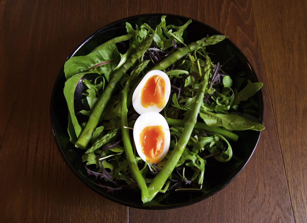 A serving of Spring Asparagus Salad with Soft Boiled eggs.