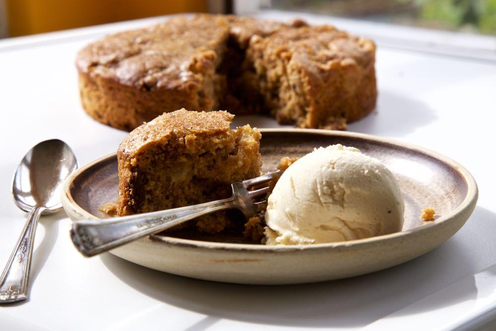 Dorset Apple Cake served with a scoop of vanilla ice cream.