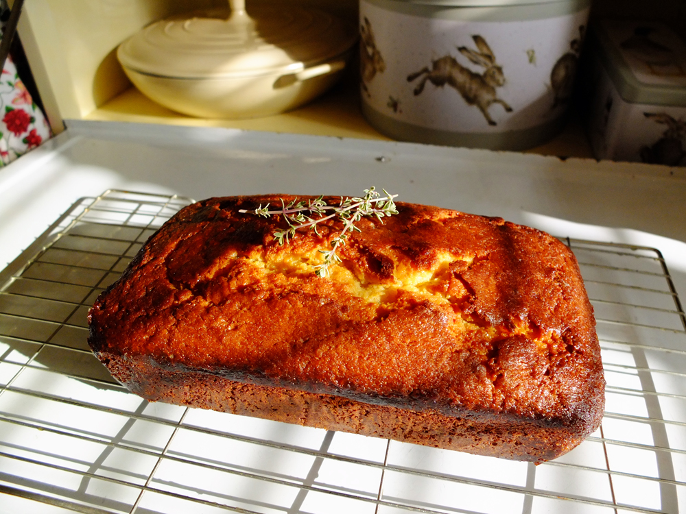 Lemon Cake with Thyme cooling on a wire rack.