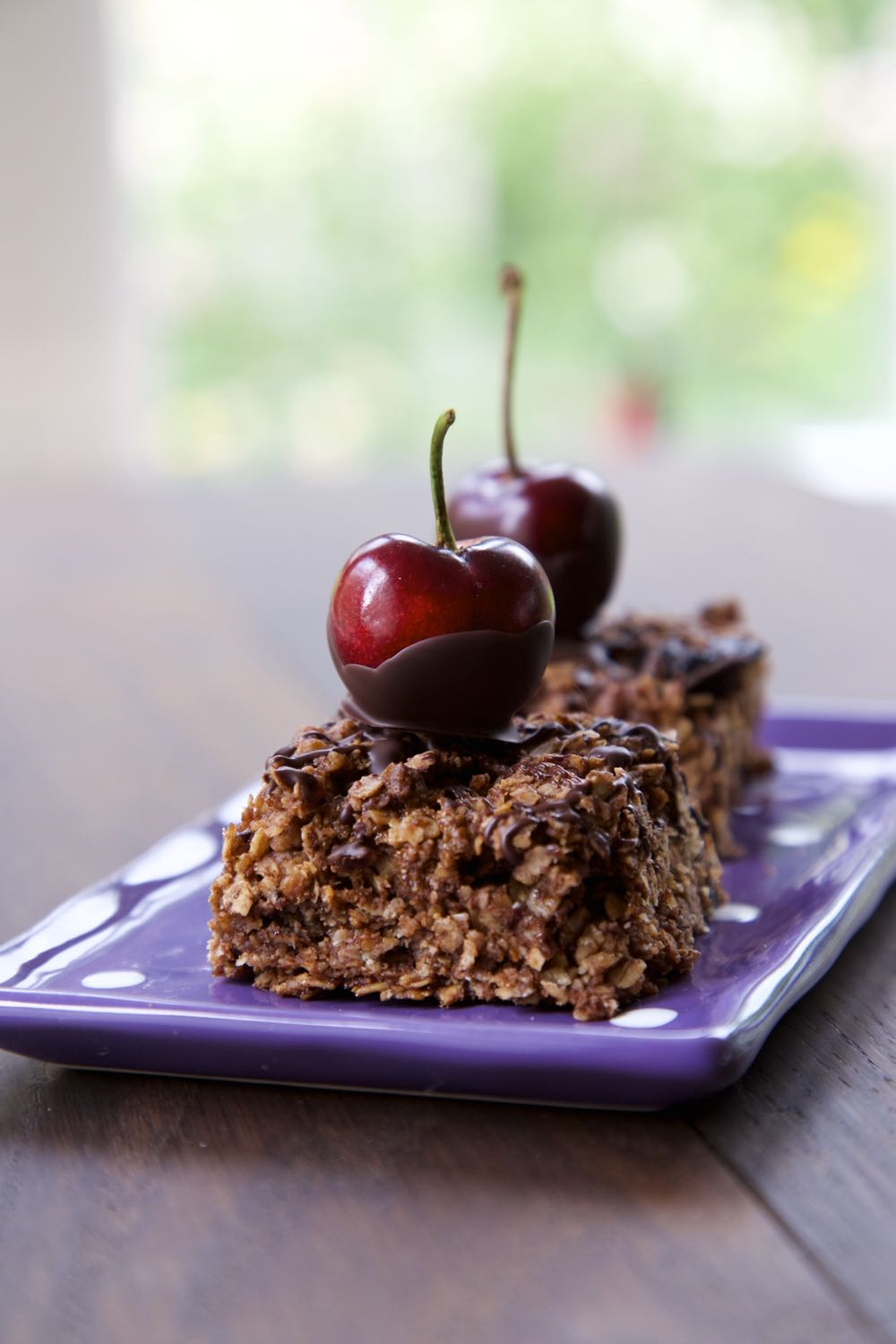 Chocolate Cherry Flapjack topped with whole chocolate coated cherries.