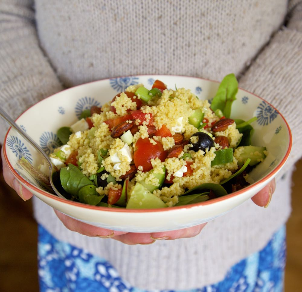 Greek Salad Couscous with feta and olives, served in a bowl.