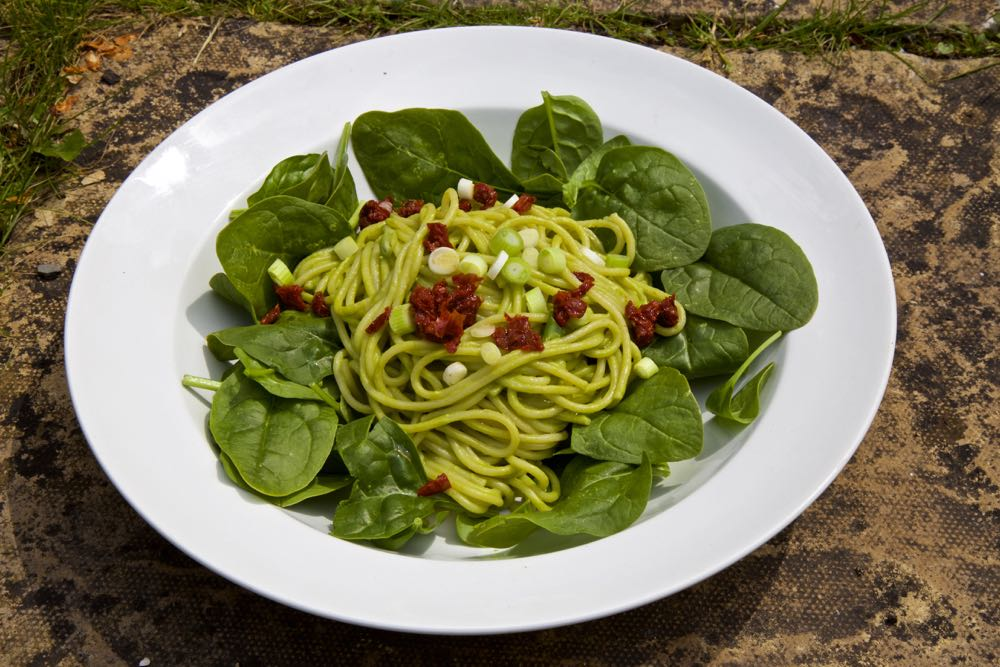 Pea Pesto and Pasta topped with spring onions and sundried tomatoes.