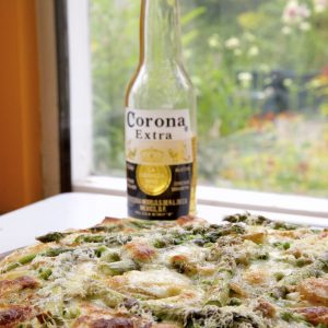 Spring Vegetable Pizza served with beer.