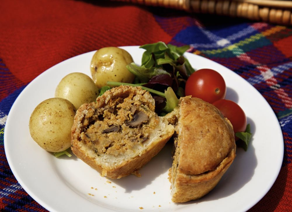 Vegan Hand Raised Pies with new potatoes, lettuce and cherry tomatoes.