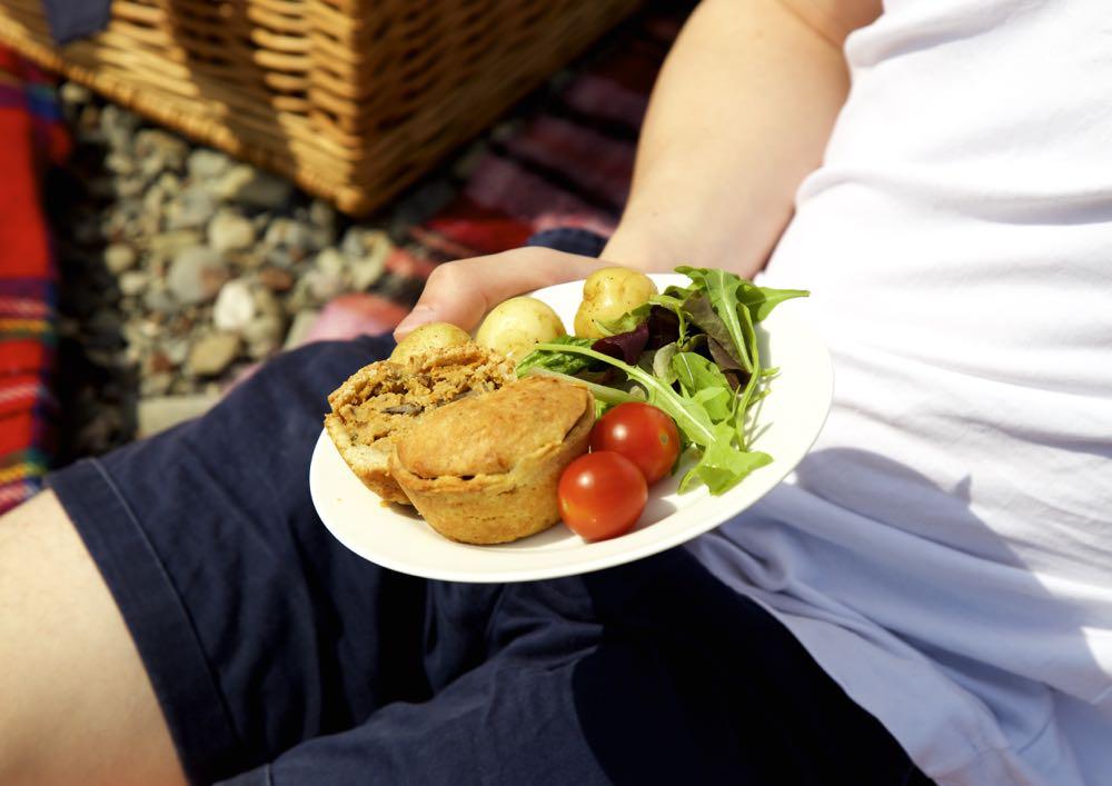 Vegan Hot Water Crust Raised Picnic Pie on the beach.