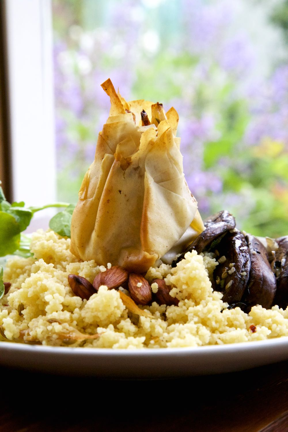 Braised Fennel and Dolcelatte Cheese in crips filo parcels served with almond couscous and portobello mushrooms.