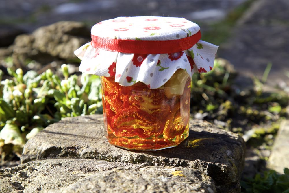 Home made sun dried tomatoes in a jar, made using the Optimum P200 Dehydrator.
