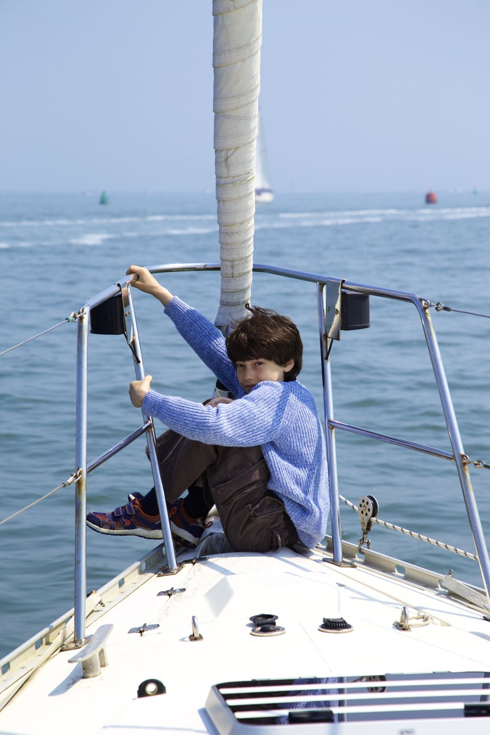 Young boy on a sailing boat.