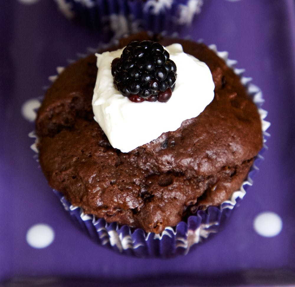 Double dark chocolate and blackberry muffins made with foraged fruit.