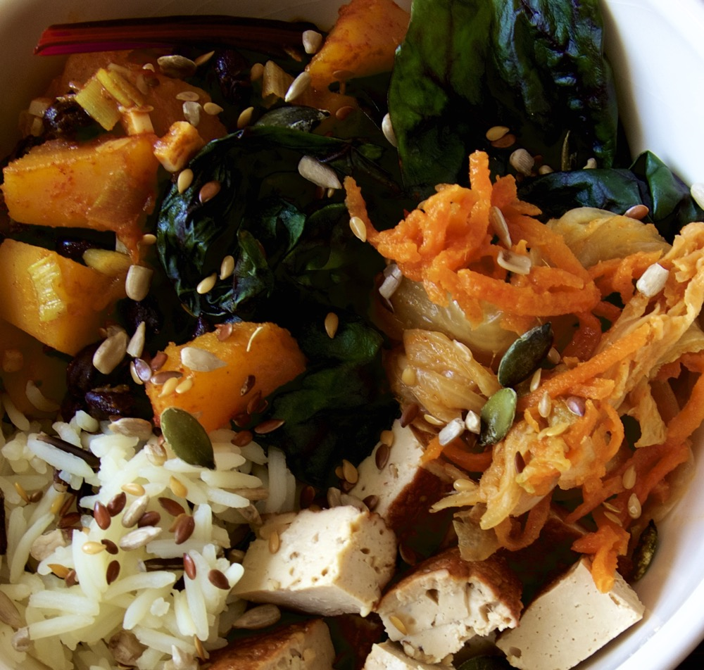 Homemade Vegan Kimchi Buddha Bowl with carrot and cabbage vegan kimchi, Spiced, roasted Butternut squash, Flash steamed Kale, Basmati and Wild Rice, Smoke Tofu and Omega Seed Sprinkle