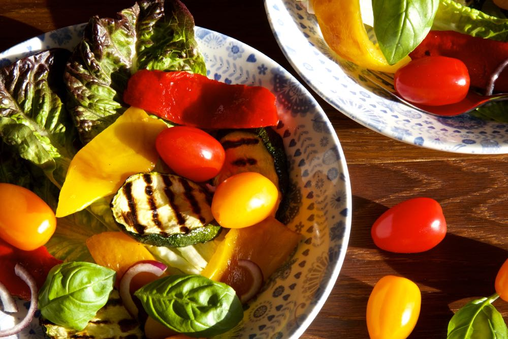 grilled vegetable salad using cherry tomatoes, peppers, courgettes and basil.