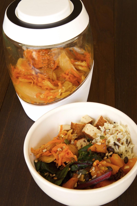 Vegan Kimchi Buddha Bowl Recipe with Homemade Vegan Kimchi, Roasted Spiced Squash, Rice, Smoked Tofu, Steamed Ruby Chard and Omega Seed Sprinkle.