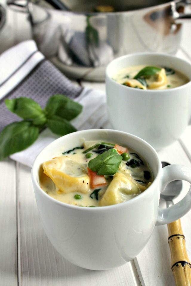 Tortellini Soup served in mugs.