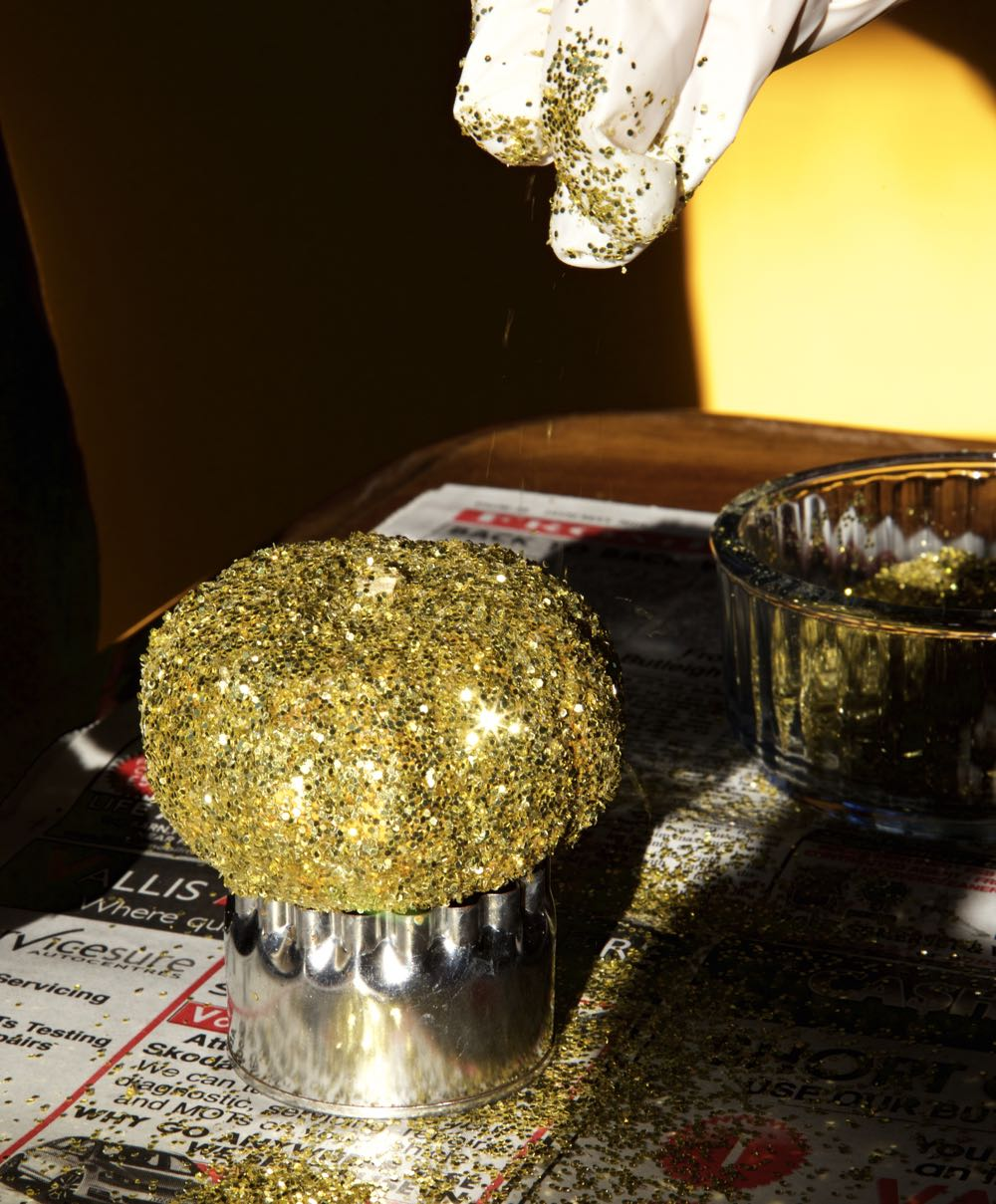 A sprinkle of glitter onto the pumpkin.
