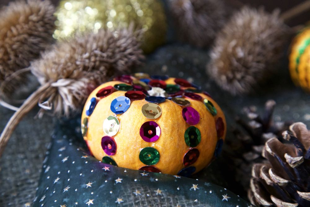 A Faberge Pumpkin with rows of multicoloured sequins.