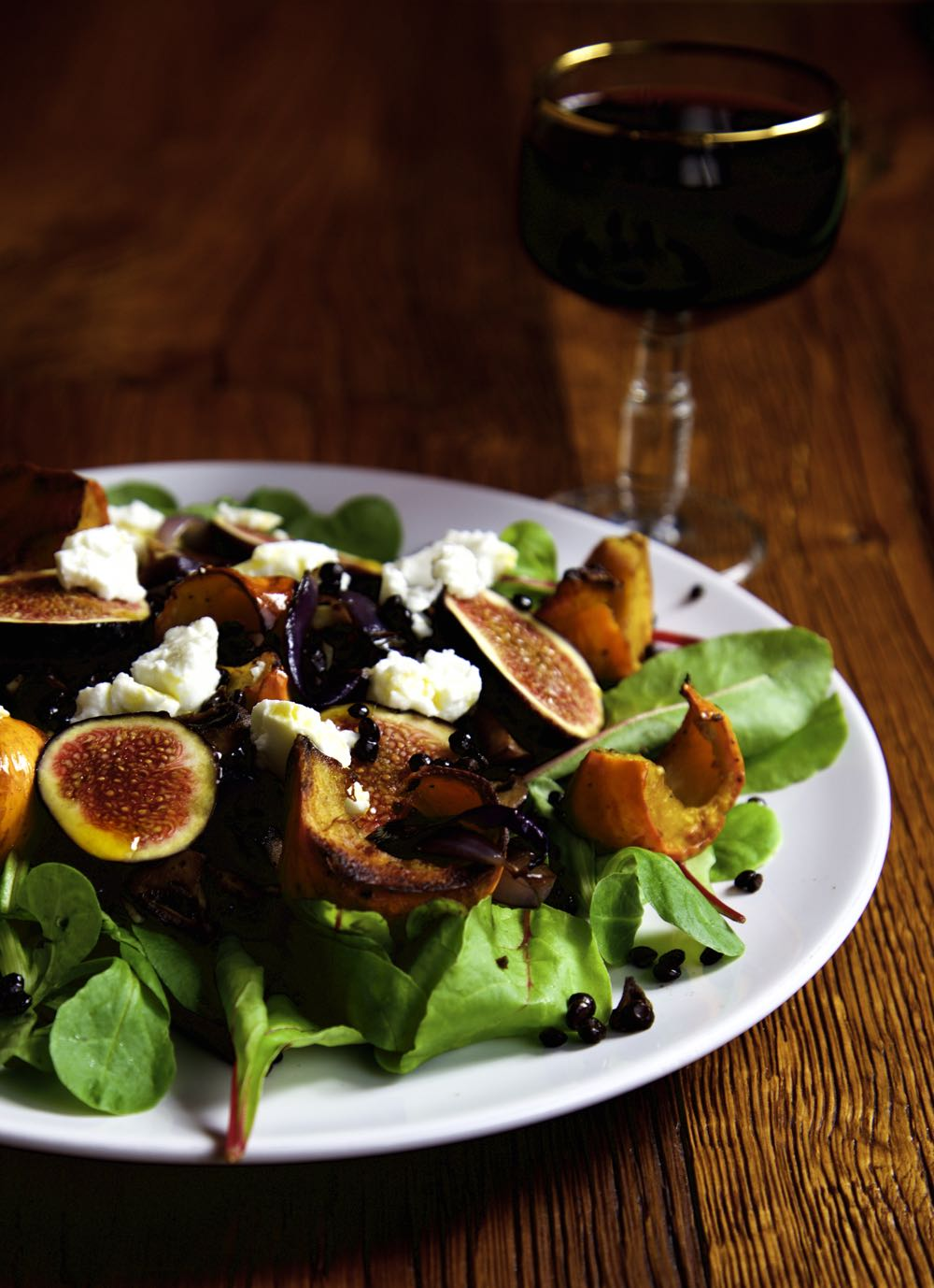 Roast Pumpkin and Fresh Fig Salad with Goat's Cheese, Beluga Lentils and Chilli Oil.