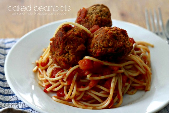 Baked Beanballs with spaghetti and tomato sauce, served on a white plate.