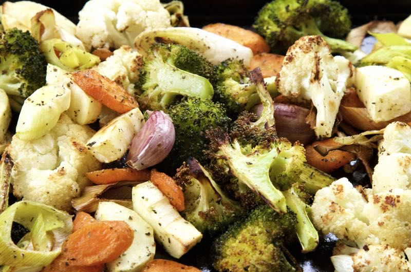 Roasted vegetables for roasted vegetable pasta bake, including broccoli, cauliflower and carrots.