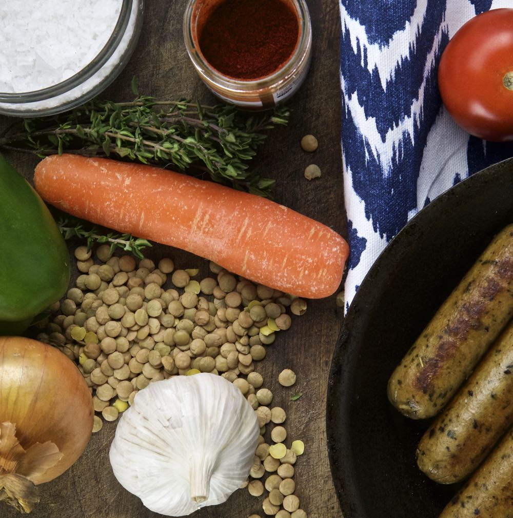 Braised Lentils with vegetarian sausages,