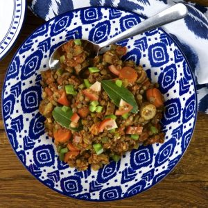 Braised lentils with vegetarian sausages, tomatoes and peppers