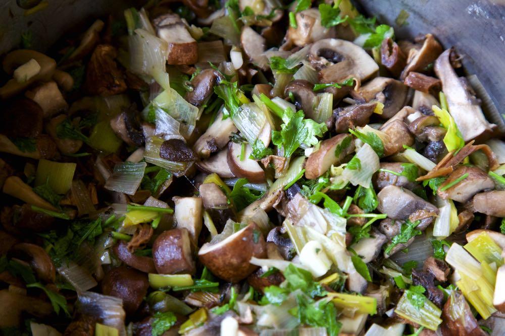 Mushroom Soup ingredients, including leek, chestnut mushrooms and parsely.
