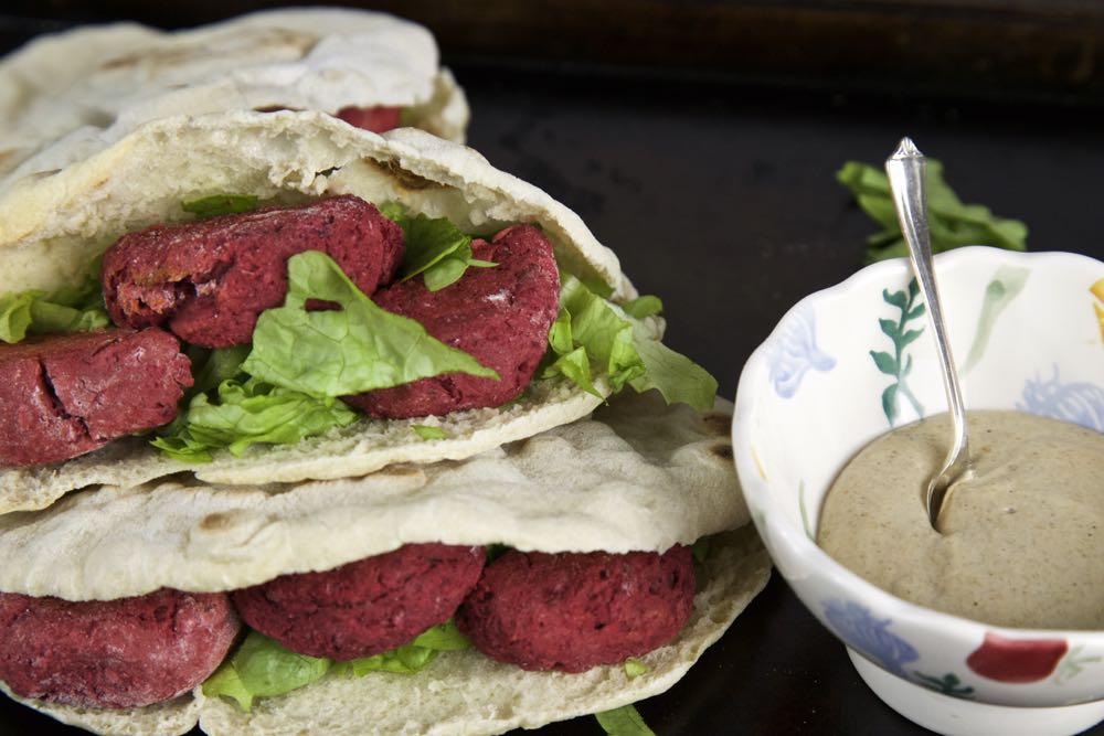 Vegan Beetroot Falafel in Homemade Pitta Bread with Crisp Salad Leaves and Tahini Dressing