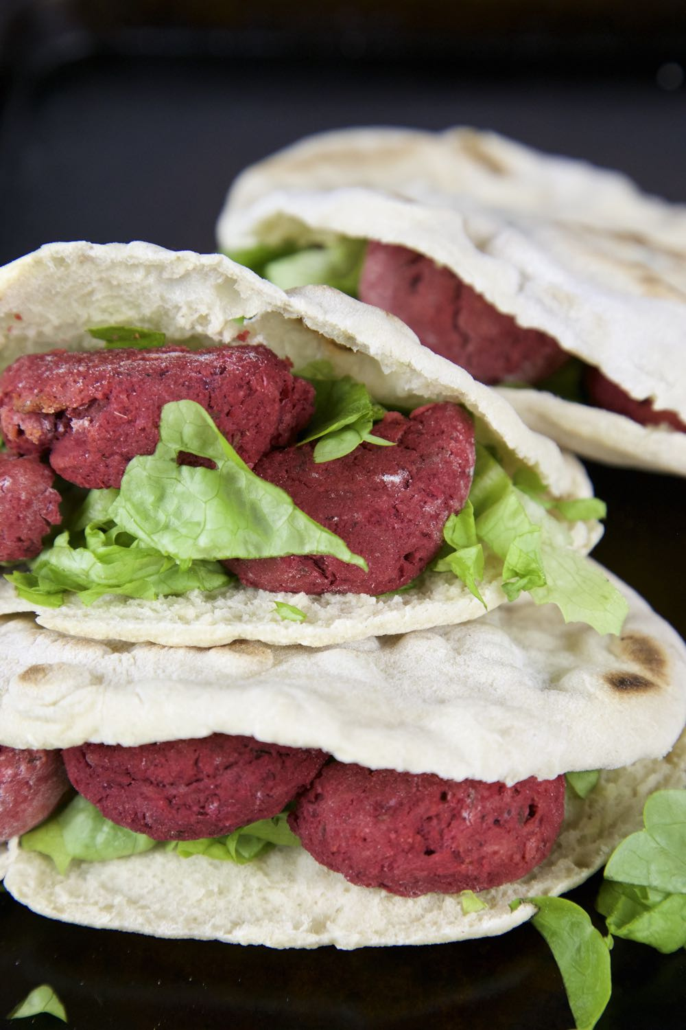 Vegan Beetroot Falafel in Homemade Pitta Bread with Crisp Salad Leaves and Tahini Dressing.