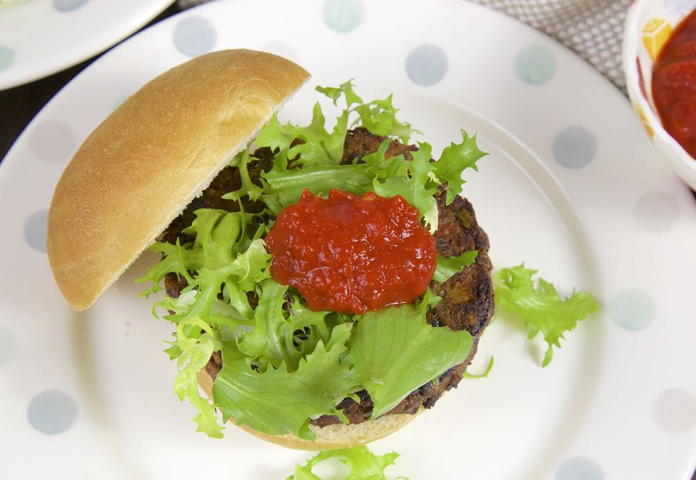 Green Lentil and Sweet Potato Burgers in a homemade bun.