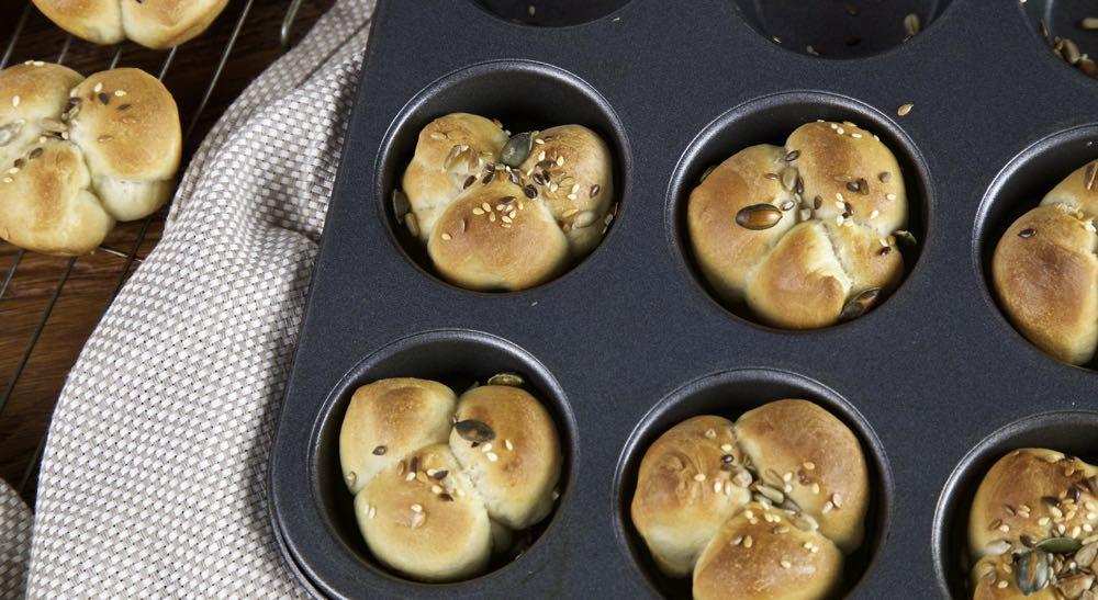 Cloverleaf Bread Rolls in a muffin tin.