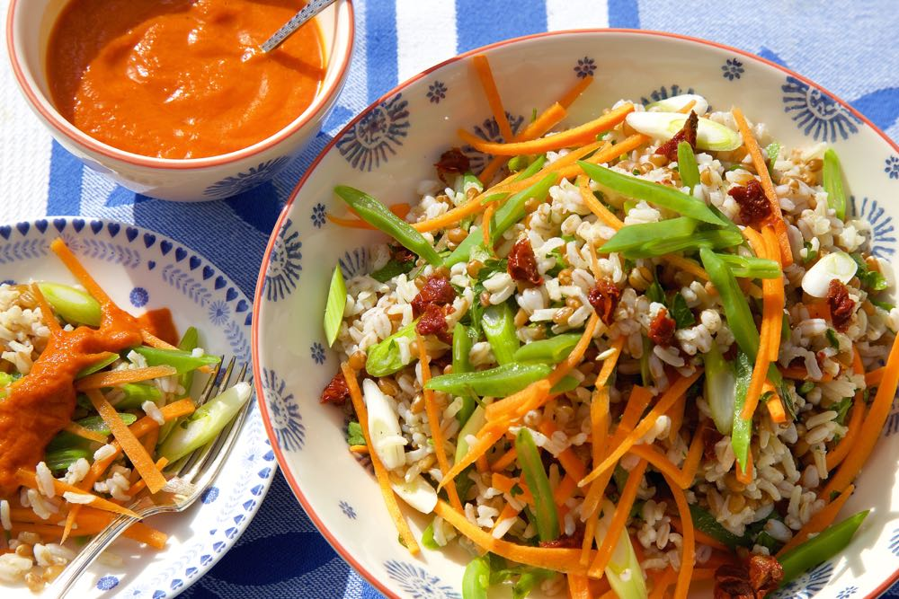 A summery three grain salad with roasted pepper sauce. Packed with flavour, crunch and bite and perfect for picnics, barbecues or just as a summer lunch!