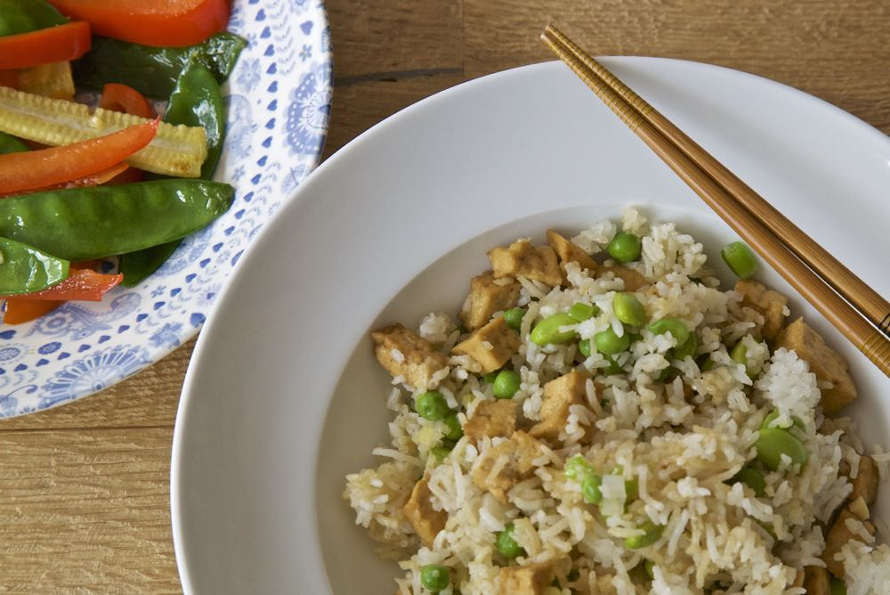 Easy Tofu Fried Rice with Stir fried vegetables in garlic, ginger and tamari.