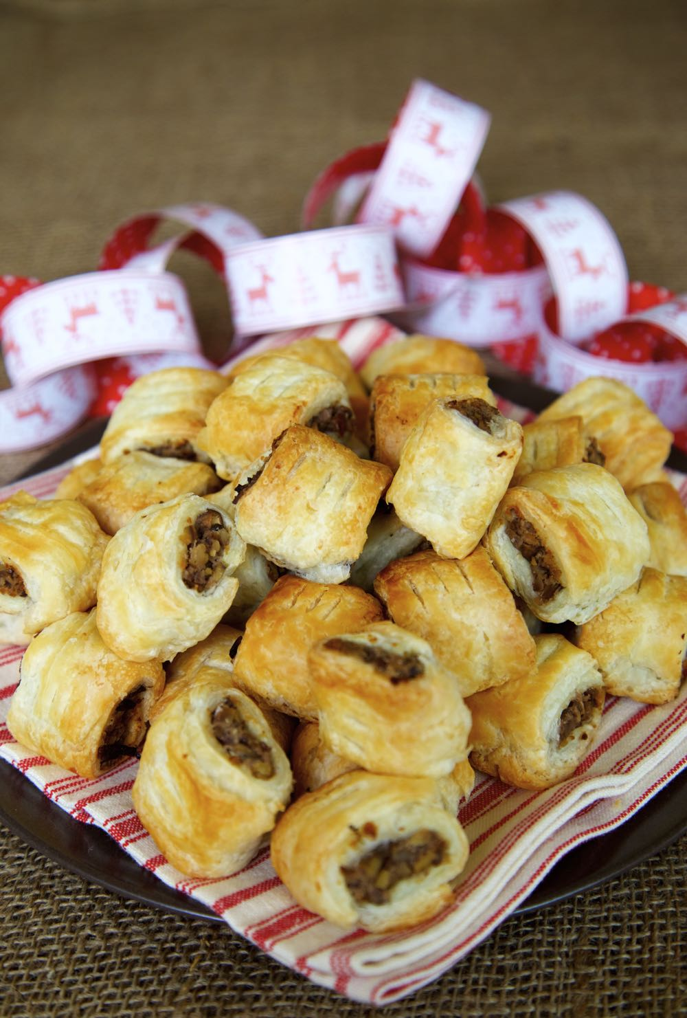 Mini vegan sausage rolls filled with chestnuts, mushrooms, red wine and herbs.