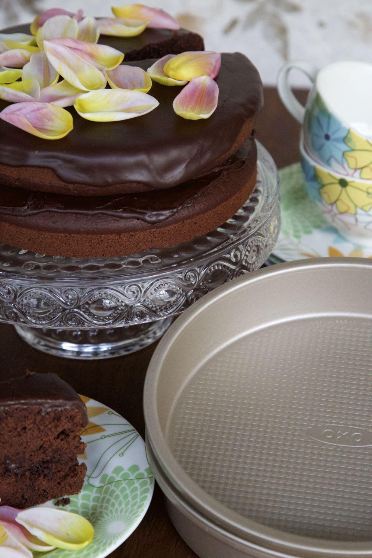 Vegan Chocolate Fudge Cake on a cake stand.