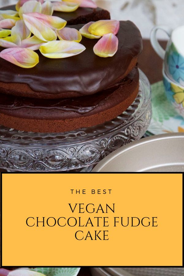 The Best Vegan Chocolate Fudge Cake, topped with tulip petals.