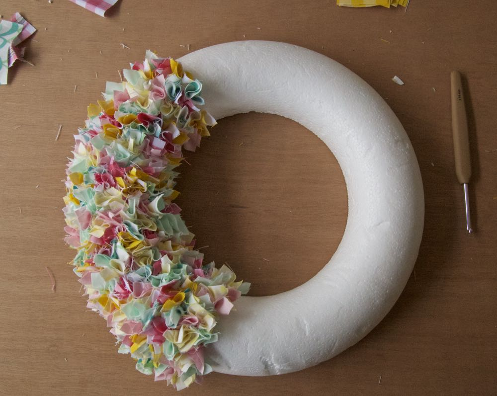 Making a spring wreath using a polystyrene wreath base and fabric scraps.