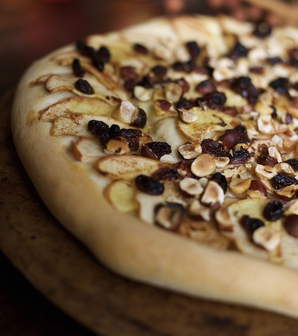 Sweet Pizza with Apple, Hazelnuts, sultanas and cinnamon.