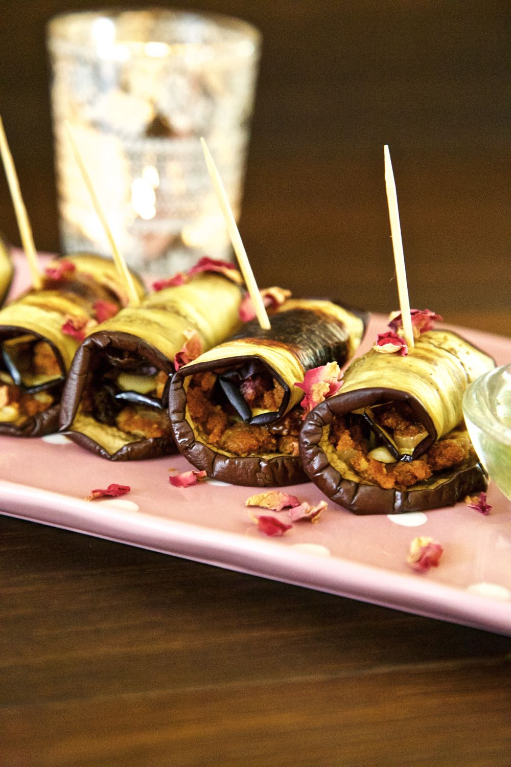 Aubergine Involtini - simple vegan canapés filled with spiced nuts and fruit served with a fresh mint dip.
