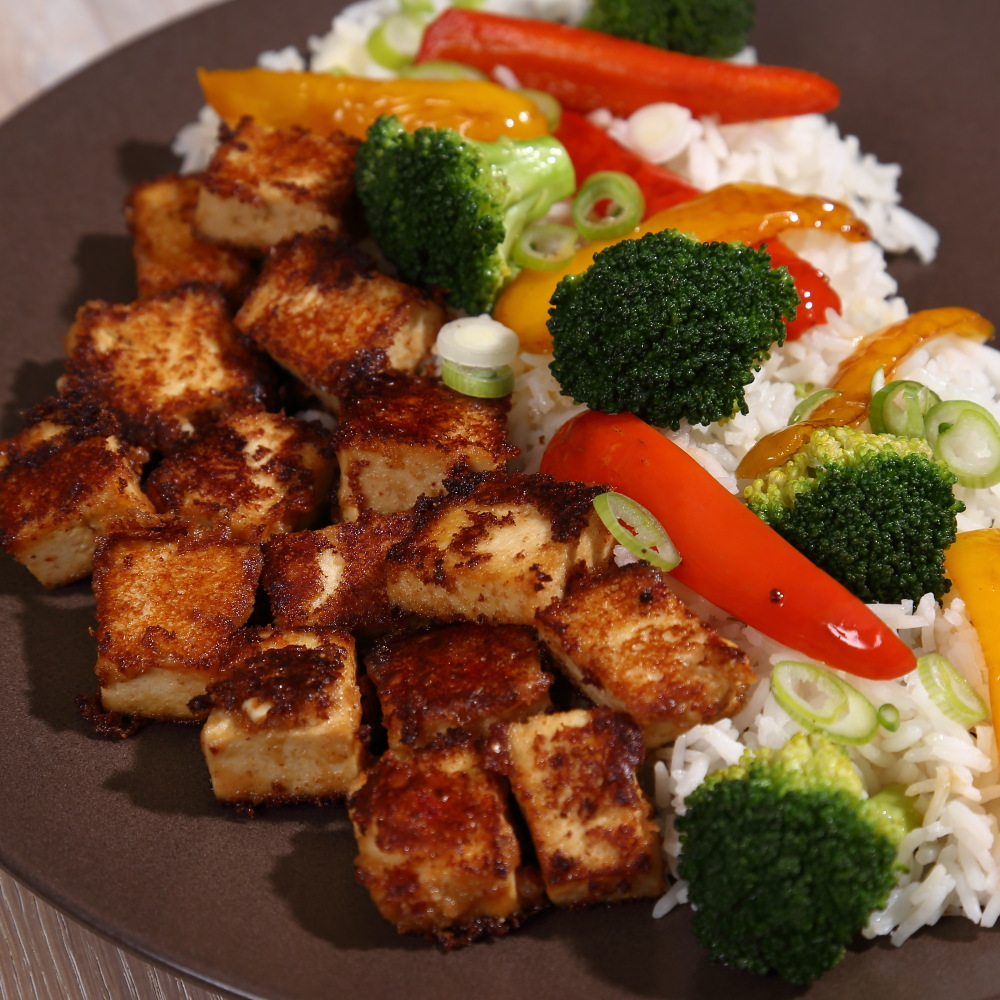 Peanut Butter Tofu with stir fried broccoli and peppers, an easy and delicious vegan meal