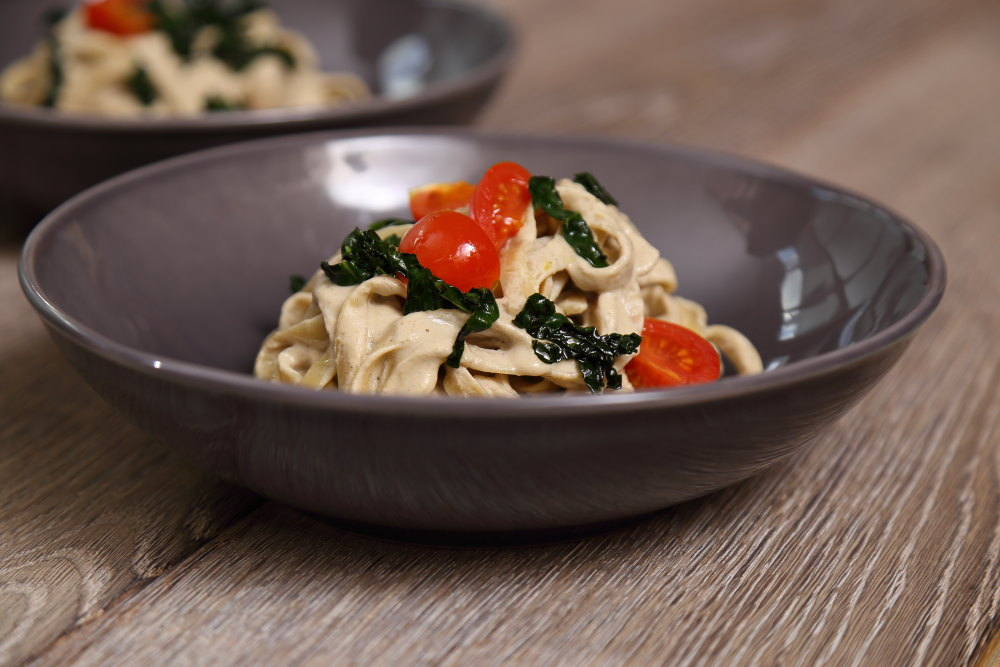 Vegan Alfredo Sauce with Tagliatelle, Cherry Tomatoes and Black Kale.