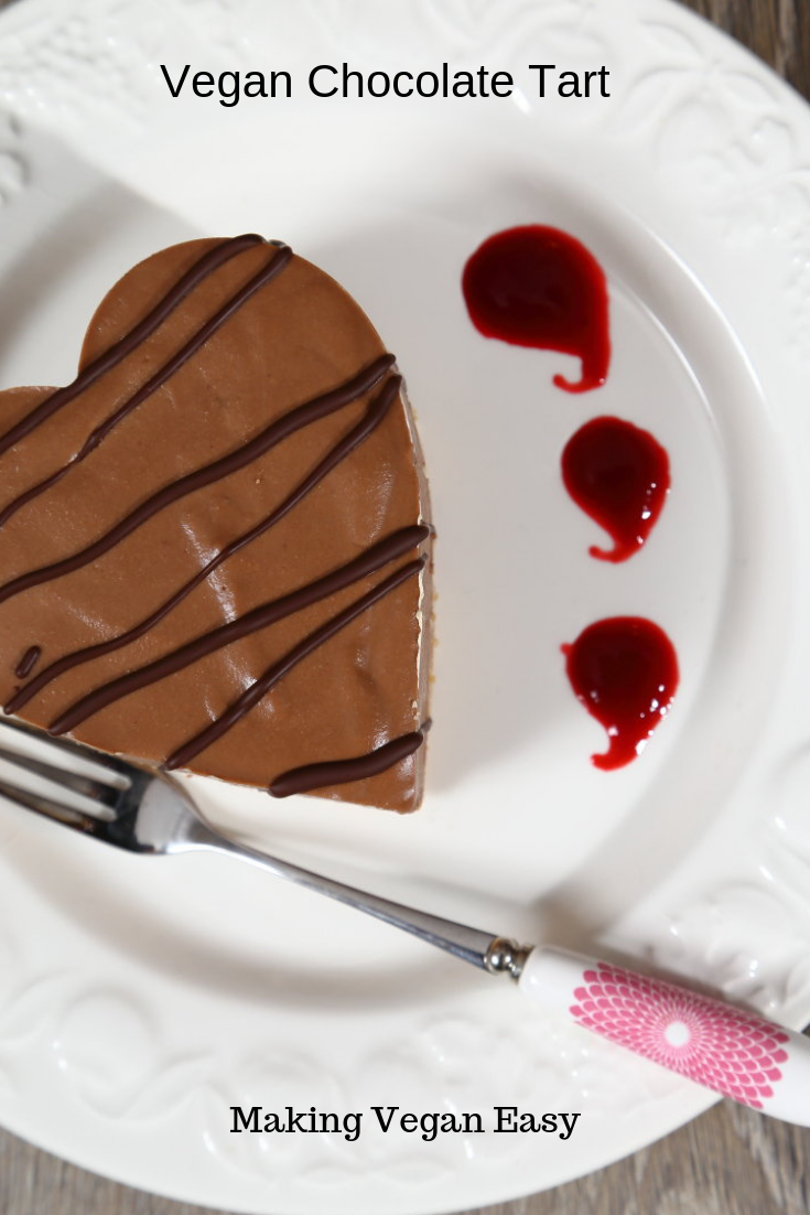 A simple vegan no bake chocolate tart with raspberry couli - perfect for your vegan Valentine!