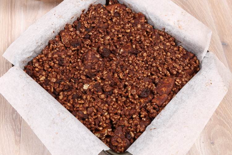 Chocolate tiffin in a square tin lined with baking paper.