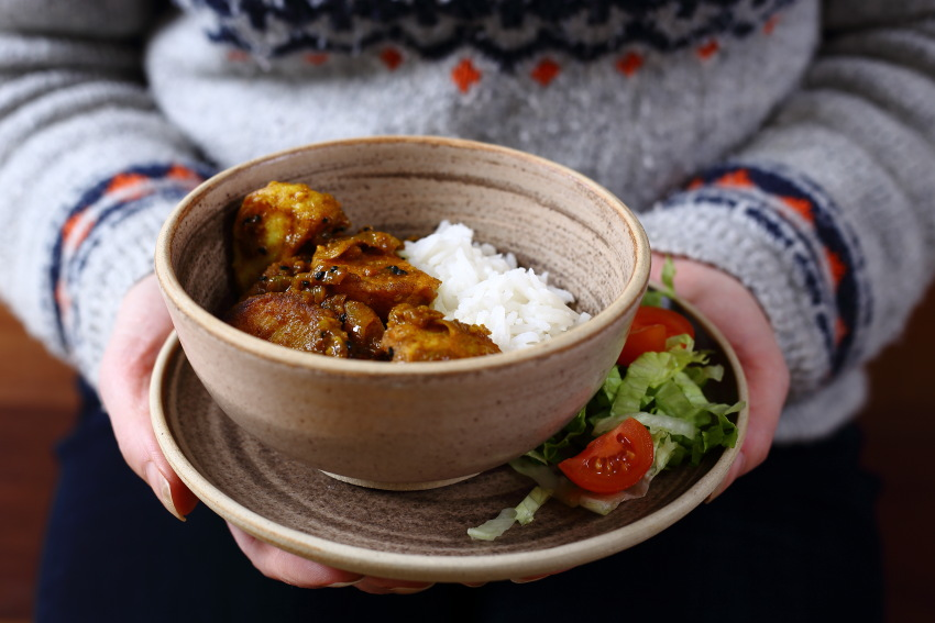 Vegan Roast Potato Curry with Rice, lettuce and tomatoes.