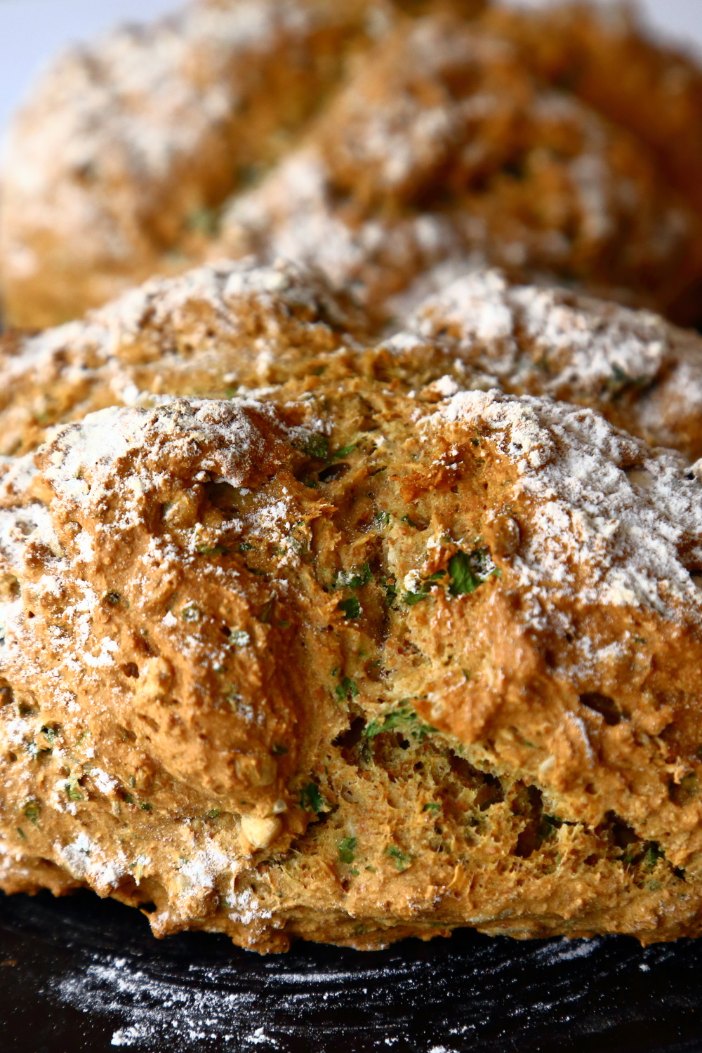 Close up of vegan soda bread showing the texture and rise.
