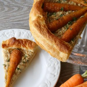 A slice of carrot and hummus tart to illustrate a simple vegan quiche recipe