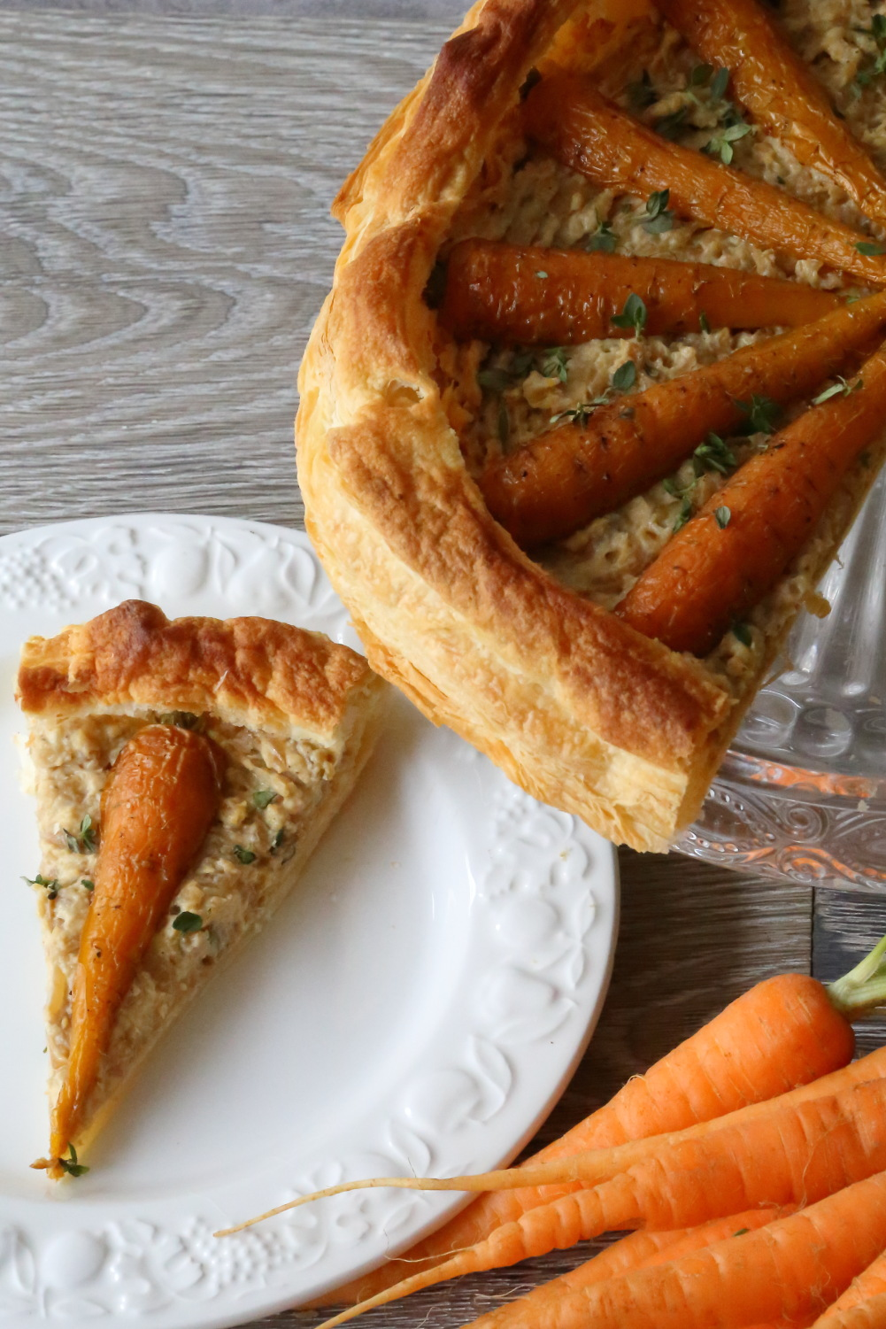 A slice of carrot and hummus tart to illustrate a simple vegan quiche recipe.