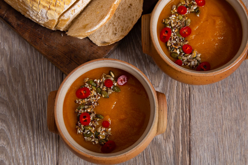 Swede Soup with chillis, seeds and bread.
