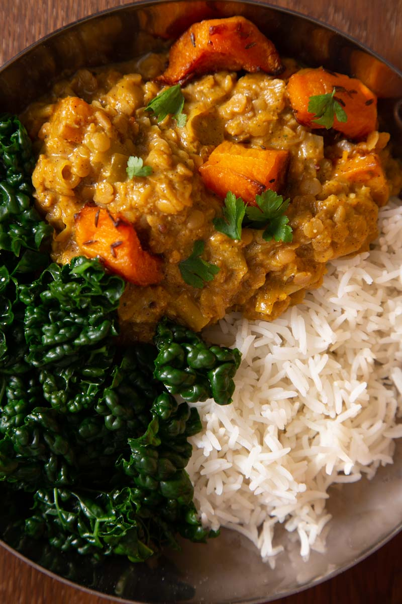 an easy pumpkin curry with rice and kale