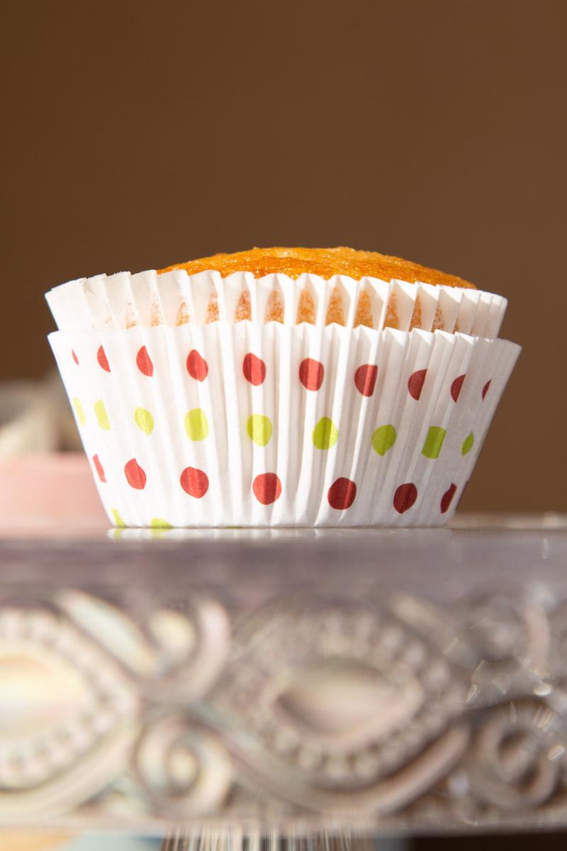 Dairy Free Vanilla Cupcake on a glass cake stand.