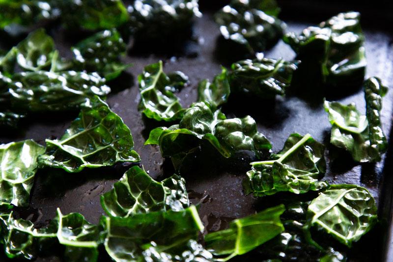Torn, roasted kale leaves.