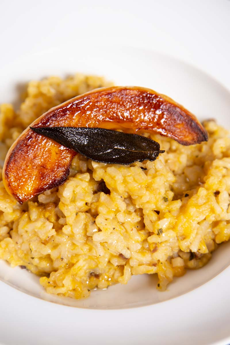 Oven baked pumpkin risotto with crispy fried sage and truffle oil